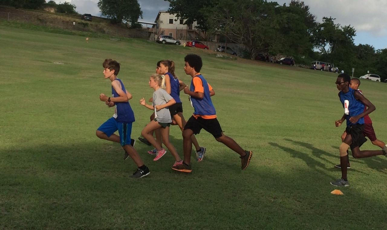 JV Runners in blue: Axel Bartsch, Ammiel Maynard, Maya Ethridge, David Dawson