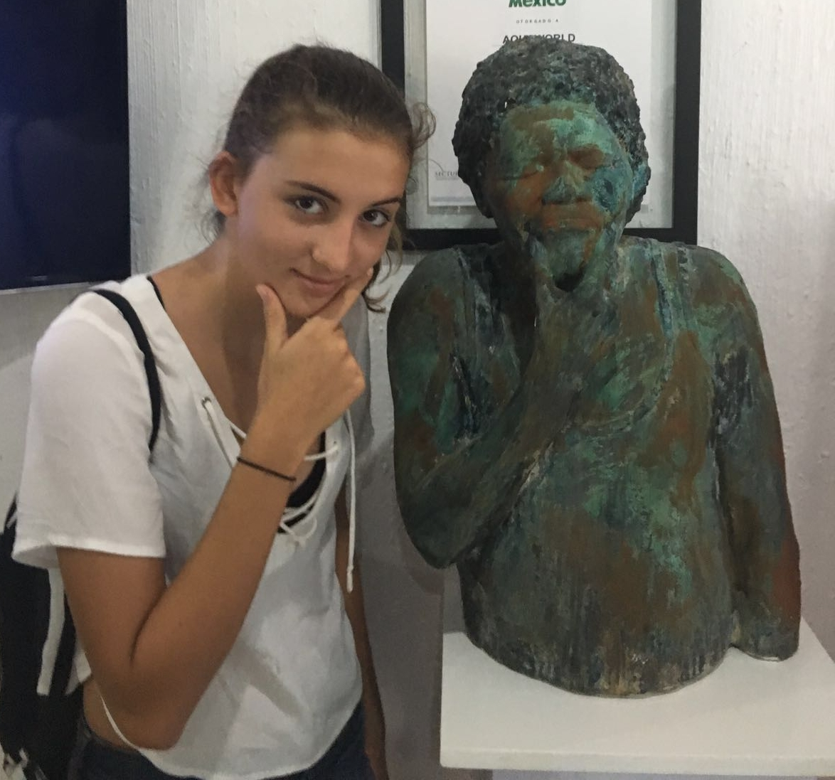 Maya with one of the statues they will see on their underwater museum tour