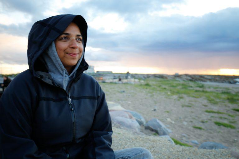 Ms. Silva enjoys a final sunset along Hudson Bay.