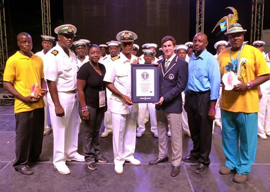 Captain Tellis Bethel, Deputy Commander Defence Force, receiving a certificate of confirmation from Guinness World Record Judge, Mr. Charlie Weisman, on behalf of the Bahamas Independence Committee with Mr. Chris Justilien (far right), the music director for the event, along with Defence Force marshals and officials.   Photos courtesy of the Royal Bahamas Defence Force