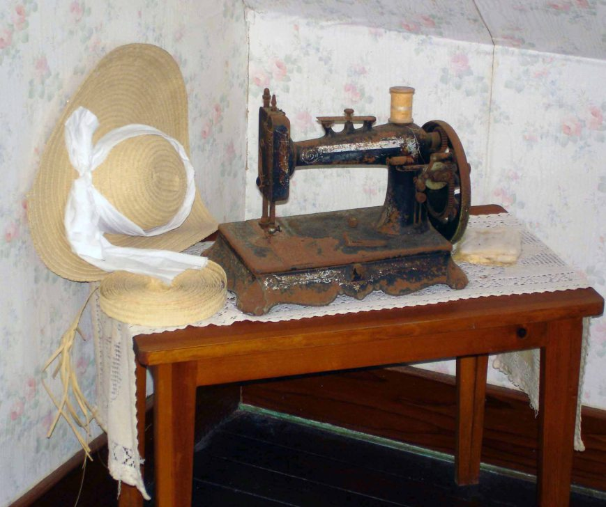 A straw hat, similar to those sewn by Ma May, and a roll of plait on display at the Albert Lowe Museum, Green Turtle Cay, Abaco