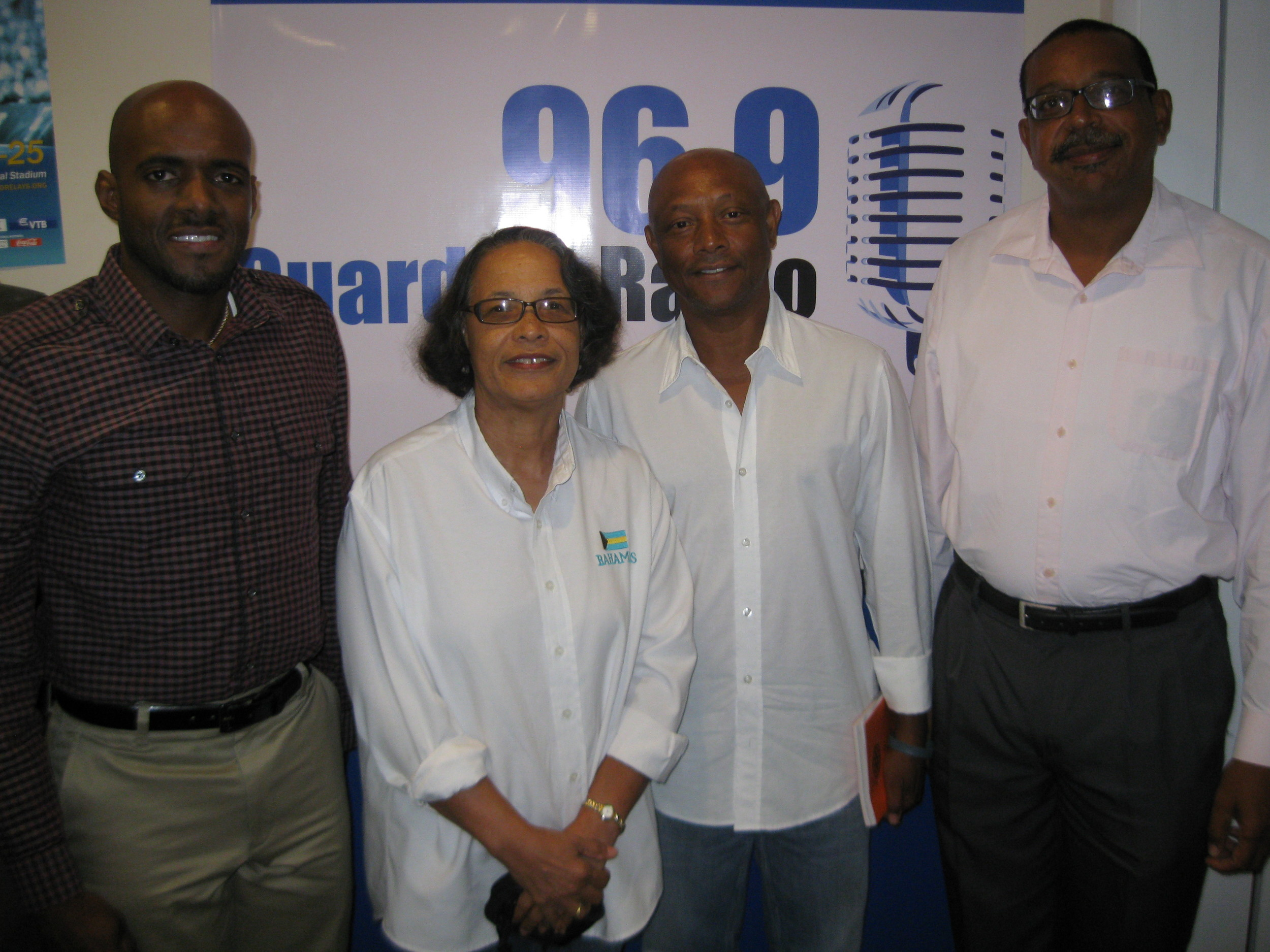 Dwight Strachan (left) and his co-host (right) with Pam and Antonius following the radio show this morning