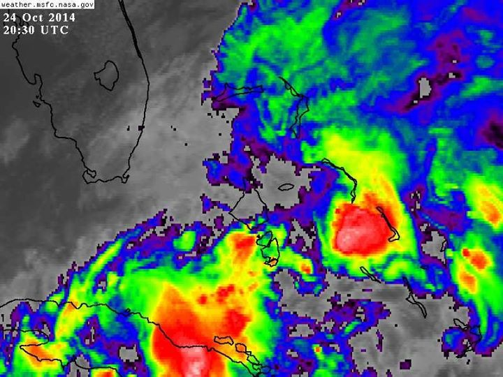 This satellite photo shows the unstable weather over Nassau last Friday (photo courtesy of Nassau Weather Live) but aren't these colours gorgeous...just like a junkanoo costume!