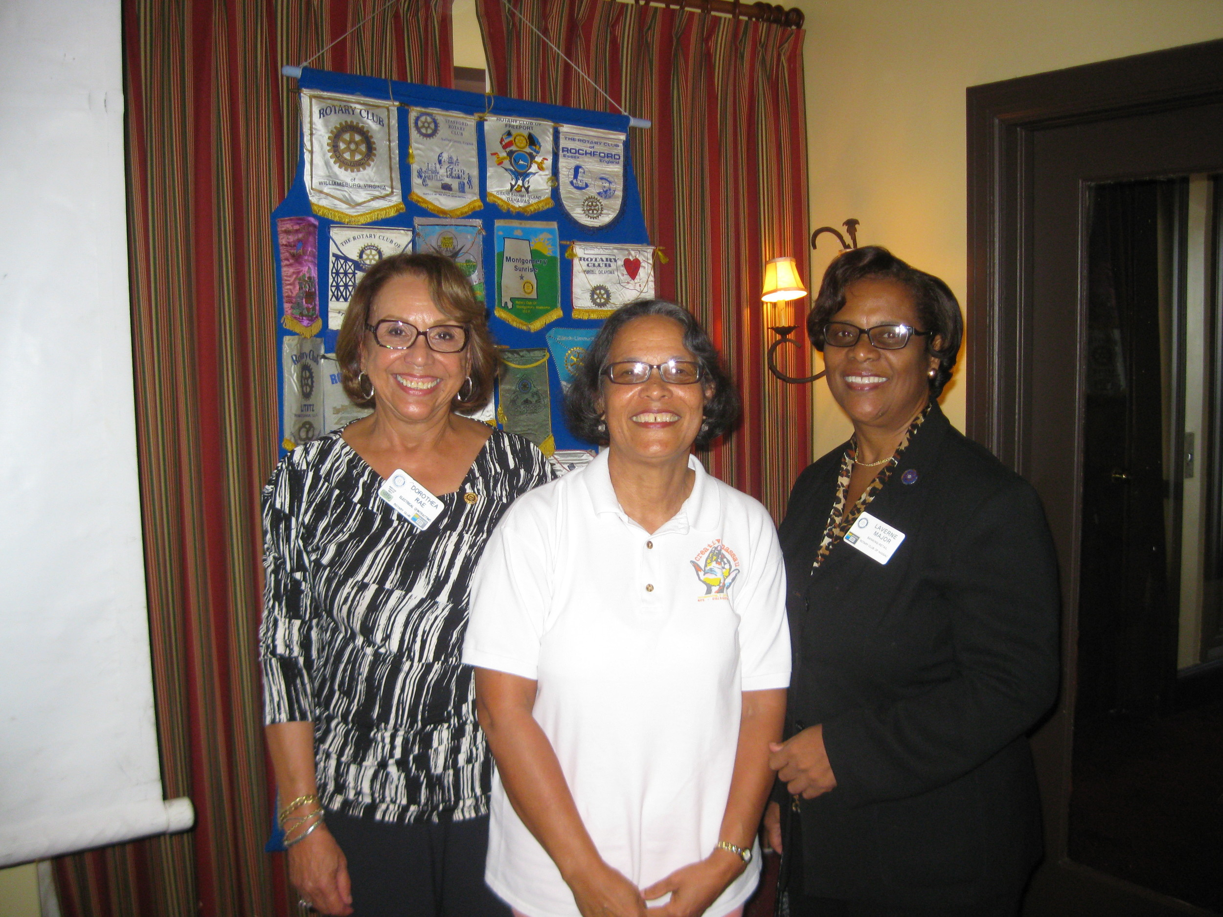 Pam Burnside (centre) with incoming Rotary President Dorothea Rae (left) and Rotarian Laverne at the presentation