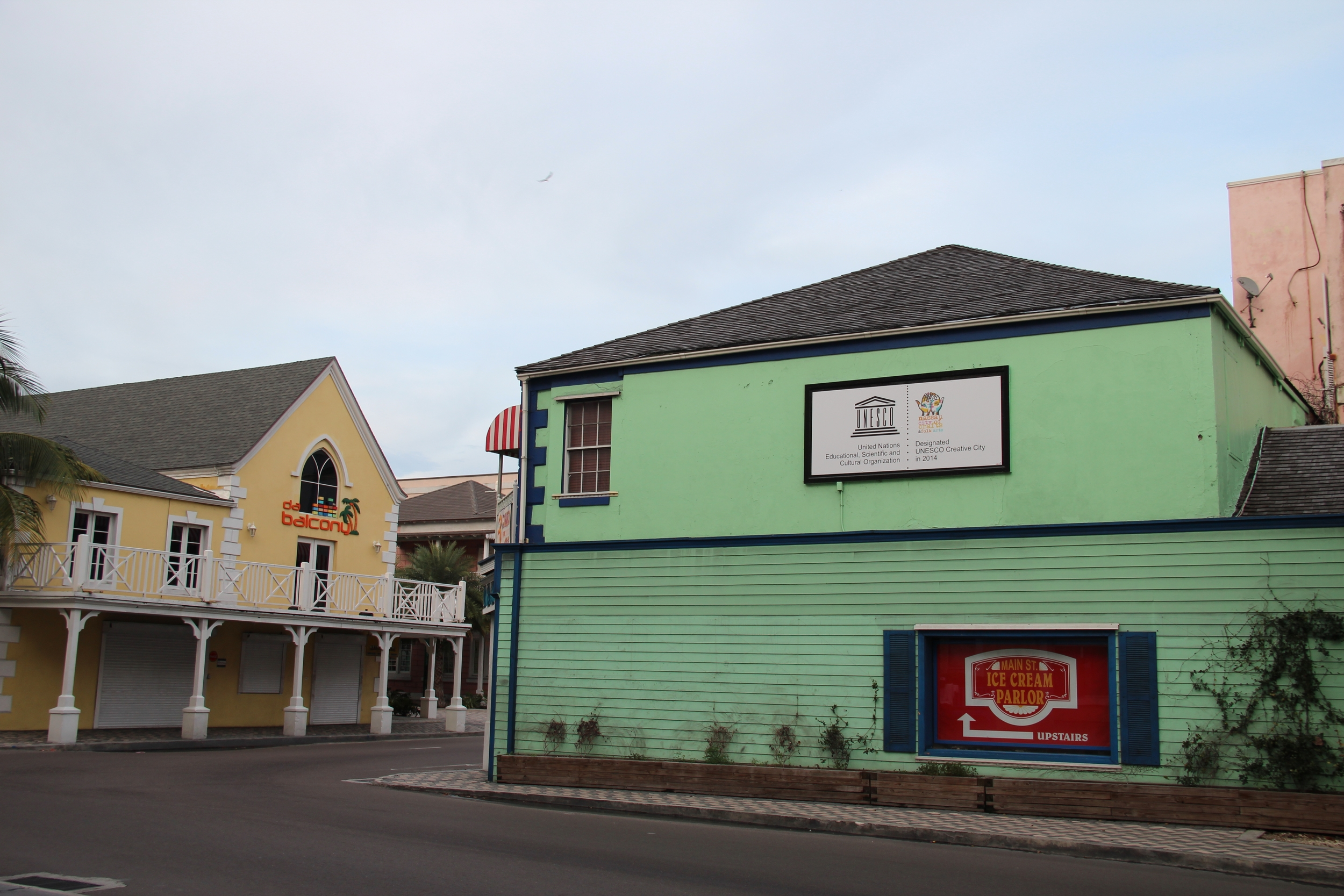The UNESCO Creative Cities banner proudly displayed at the entrance of Downtown Bay Street in the City of Nassau, Bahamas. Photograph by Rosemary C. Hanna