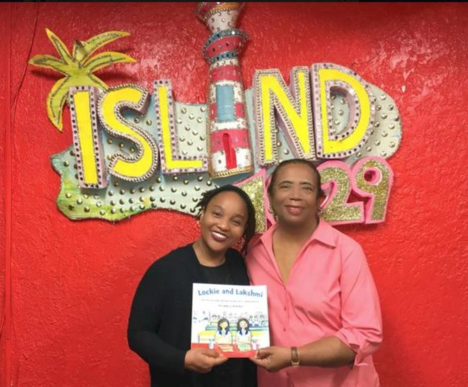 Kelley with her new book, poses with Patti following the Radio interview at Island FM 102.9