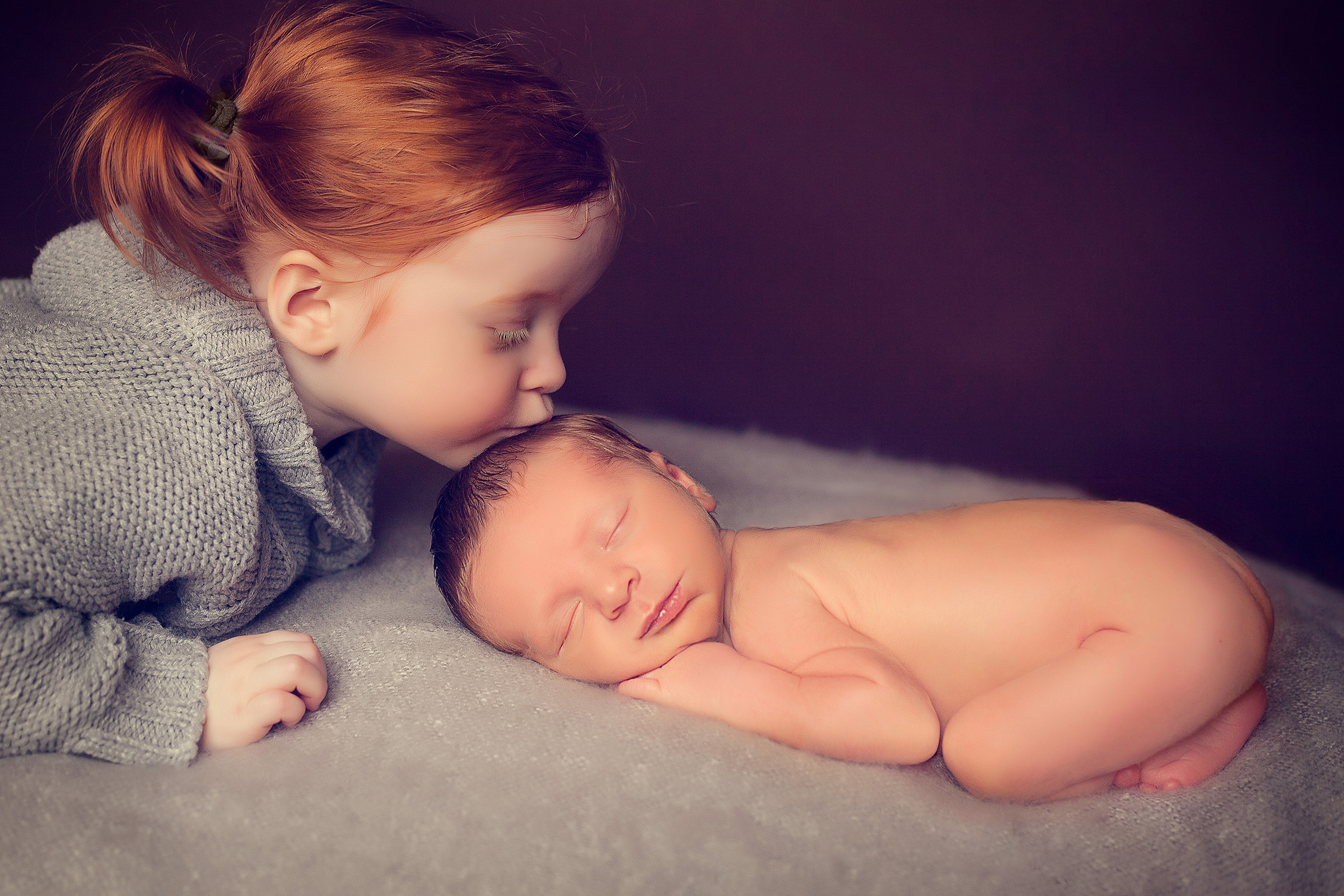 newborn baby boy and his big sister