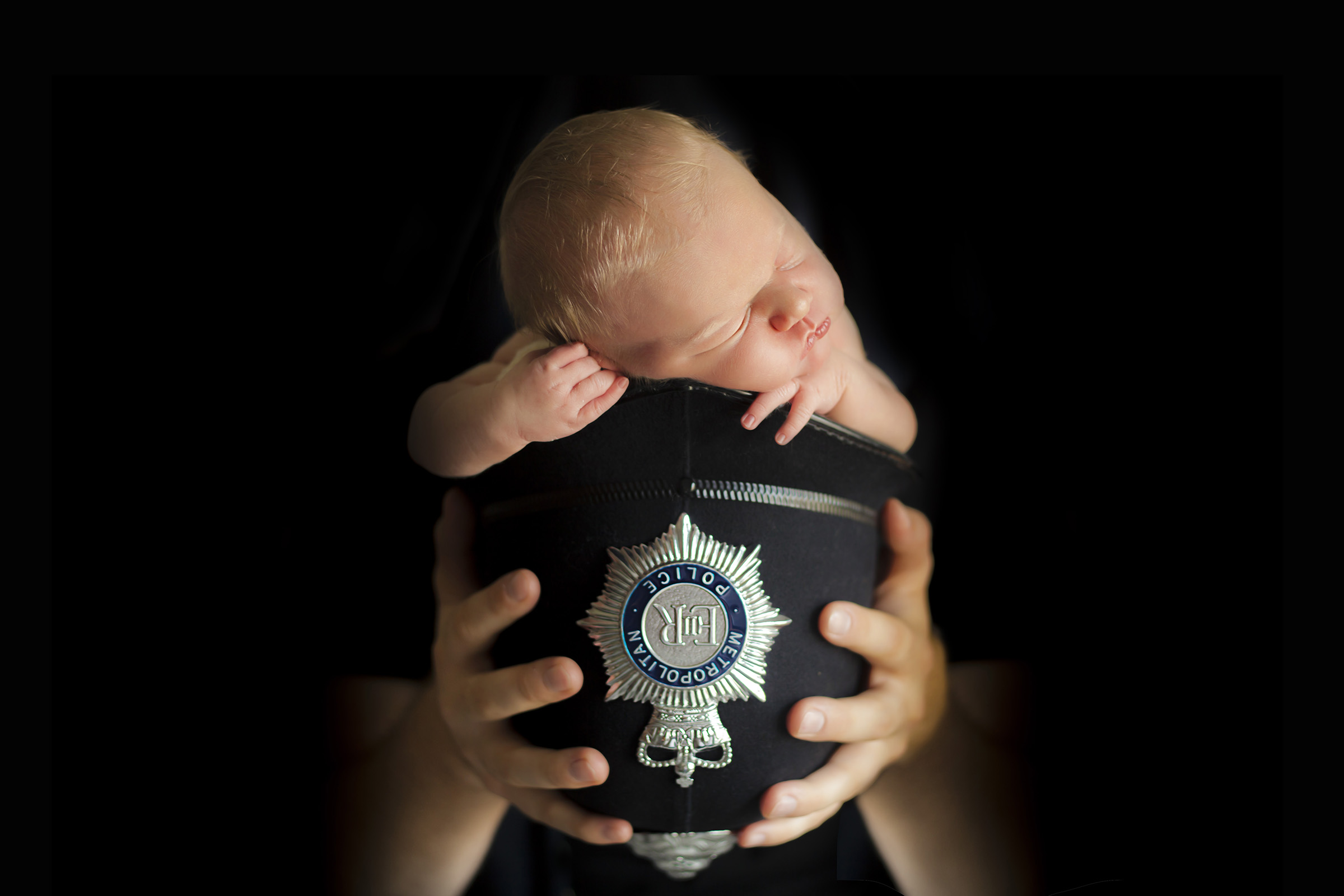 baby in policeman hat