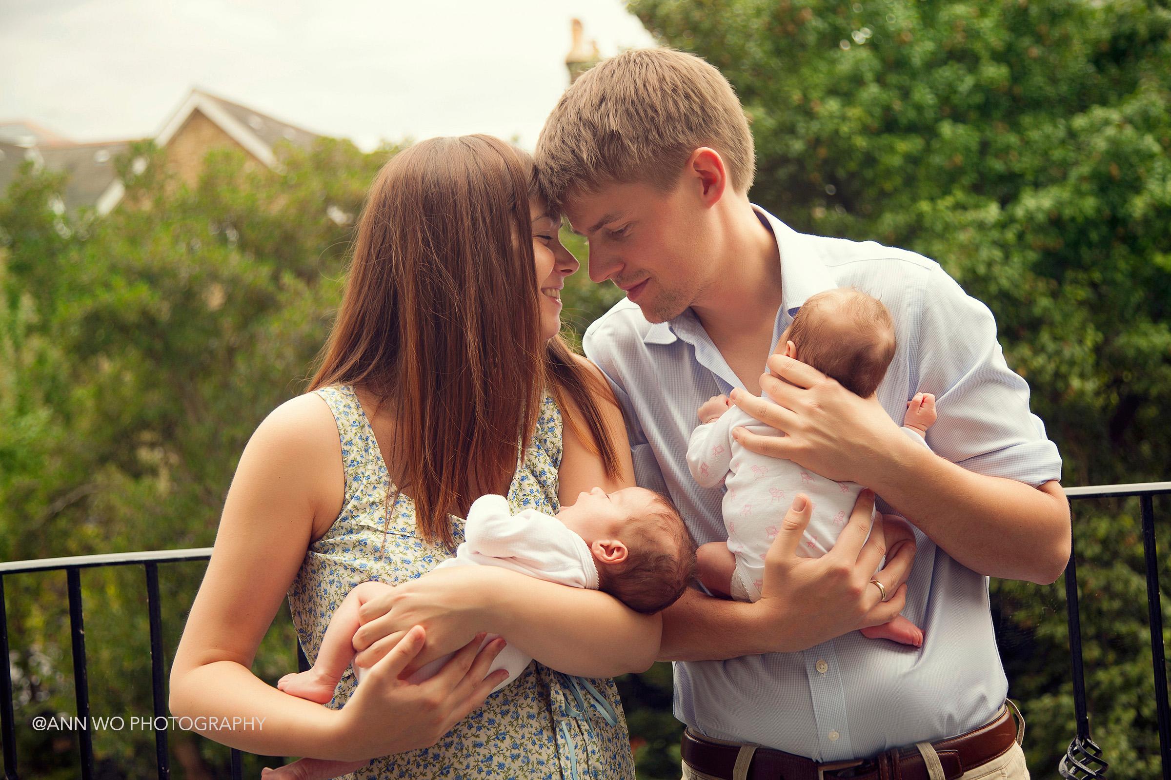 newborn twins with parents