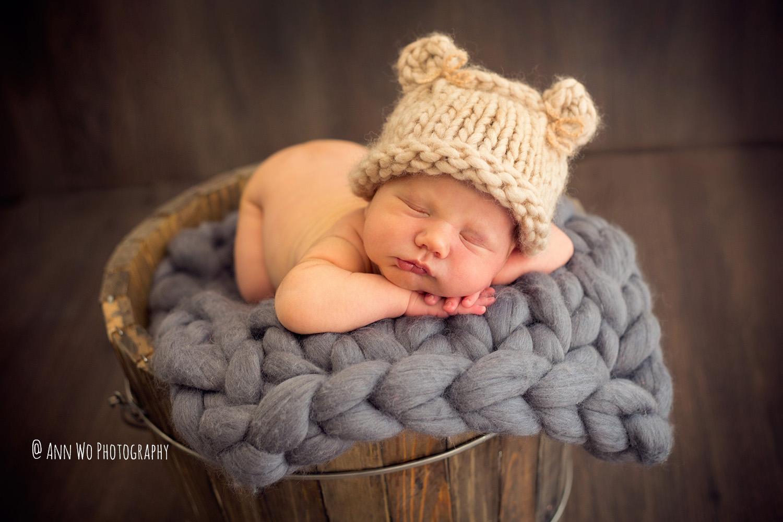 newborn baby in bear hat ann wo photography maidenhead uk