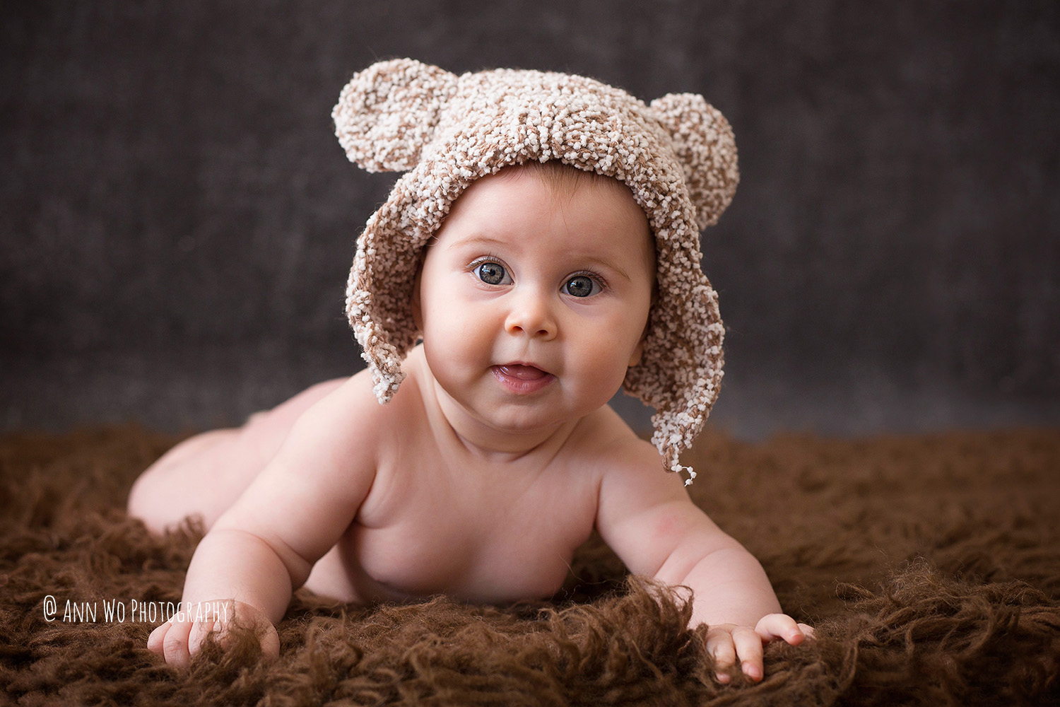 6 month baby in bear hat ann wo photographer