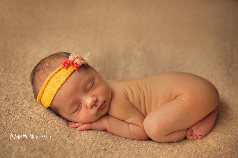 newborn baby girl with yellow headband
