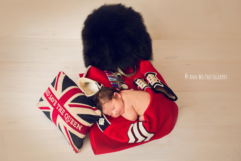 newborn baby photo sleeping on welsh guard uniform ann wo photographer london