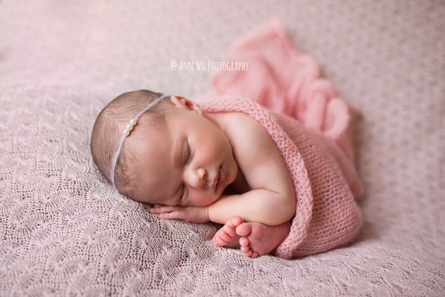 pink blanket and knit wrap newborn baby girl London photographer Ann Wo