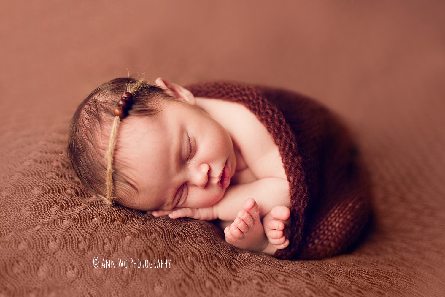 Newborn baby photographer in London brown setup