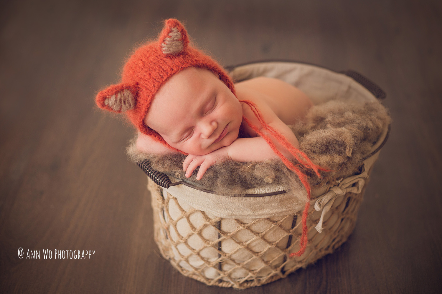 Newborn photography in London by Ann Wo fox hat basket