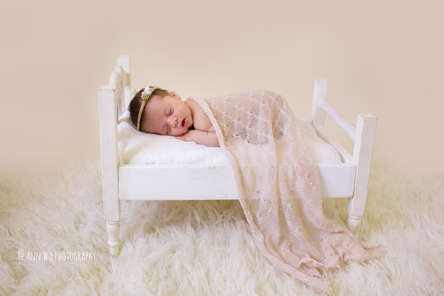 Newborn photography in London by Ann Wo white bed