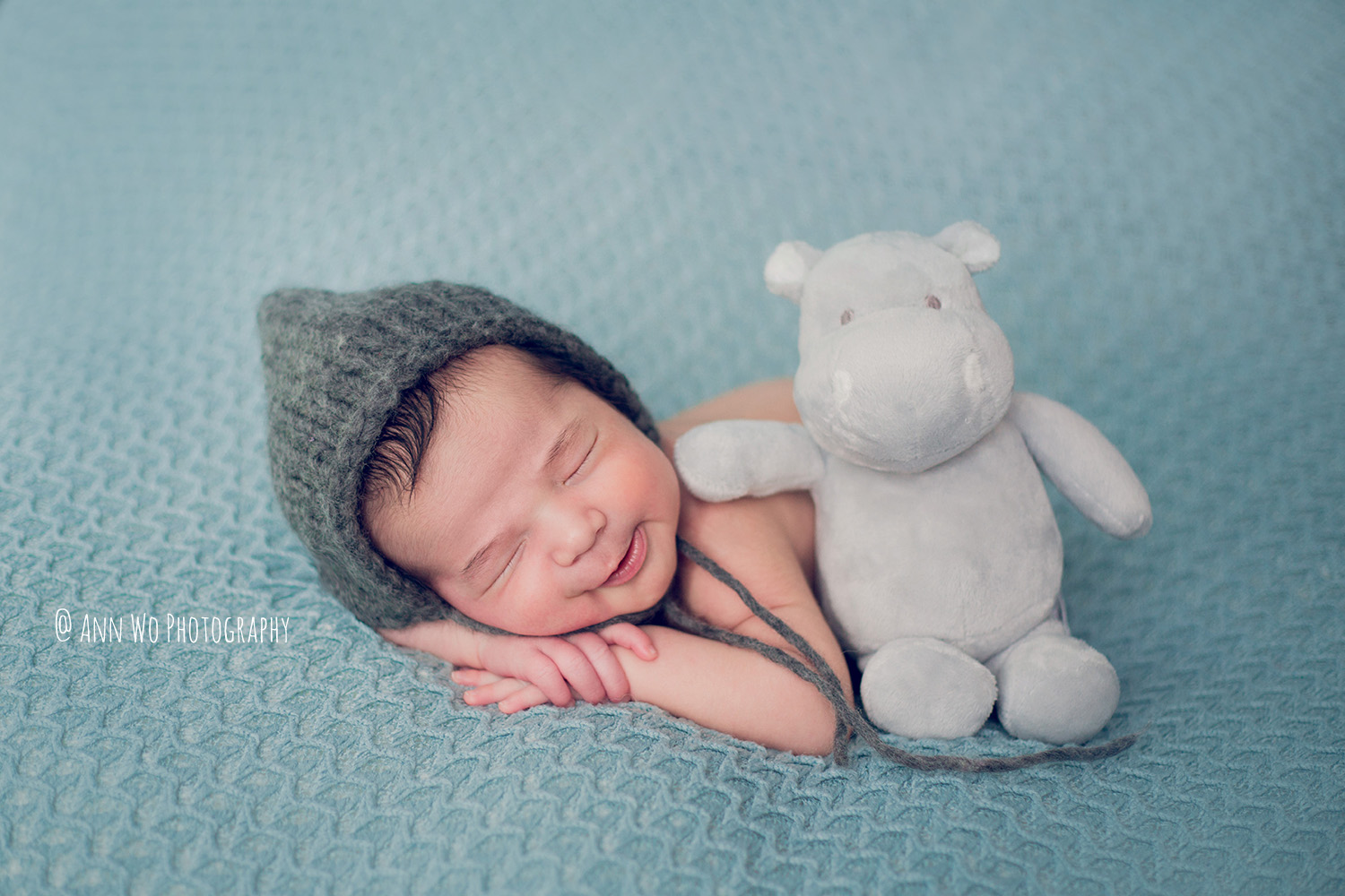 adorable newborn baby smiling by Ann Wo photography in London