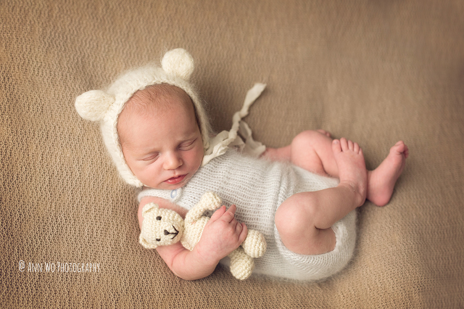 newborn baby romper and teddy bear Ann Wo photography  in London
