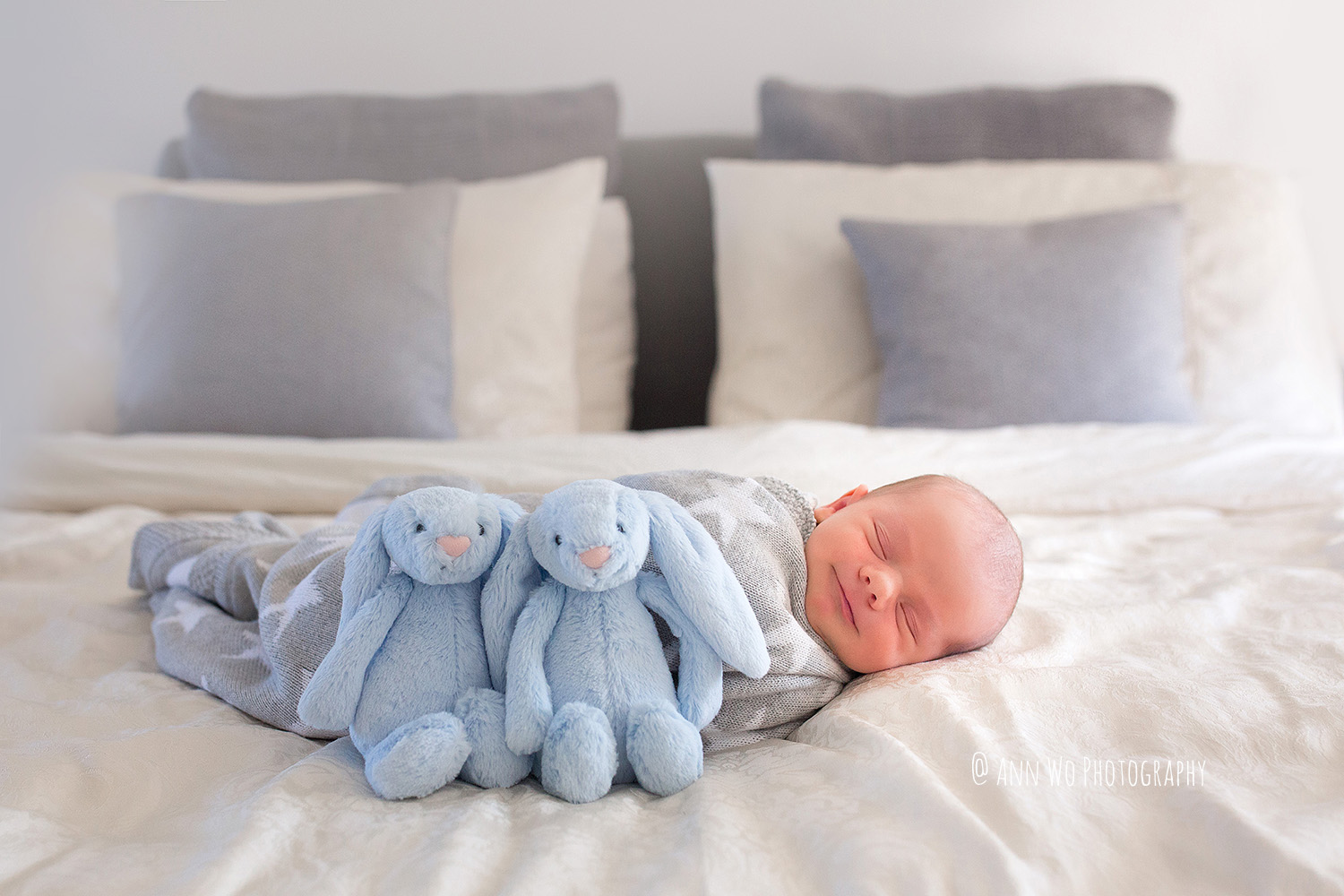 lifestyle-newborn-photography-london-baby-with-toys-smiling-sleeping.JPG