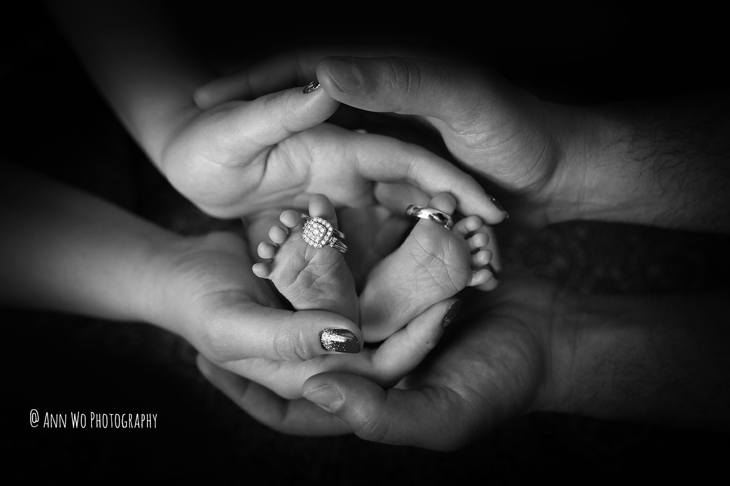 newborn baby feet with wedding rings - London Ann Wo photography