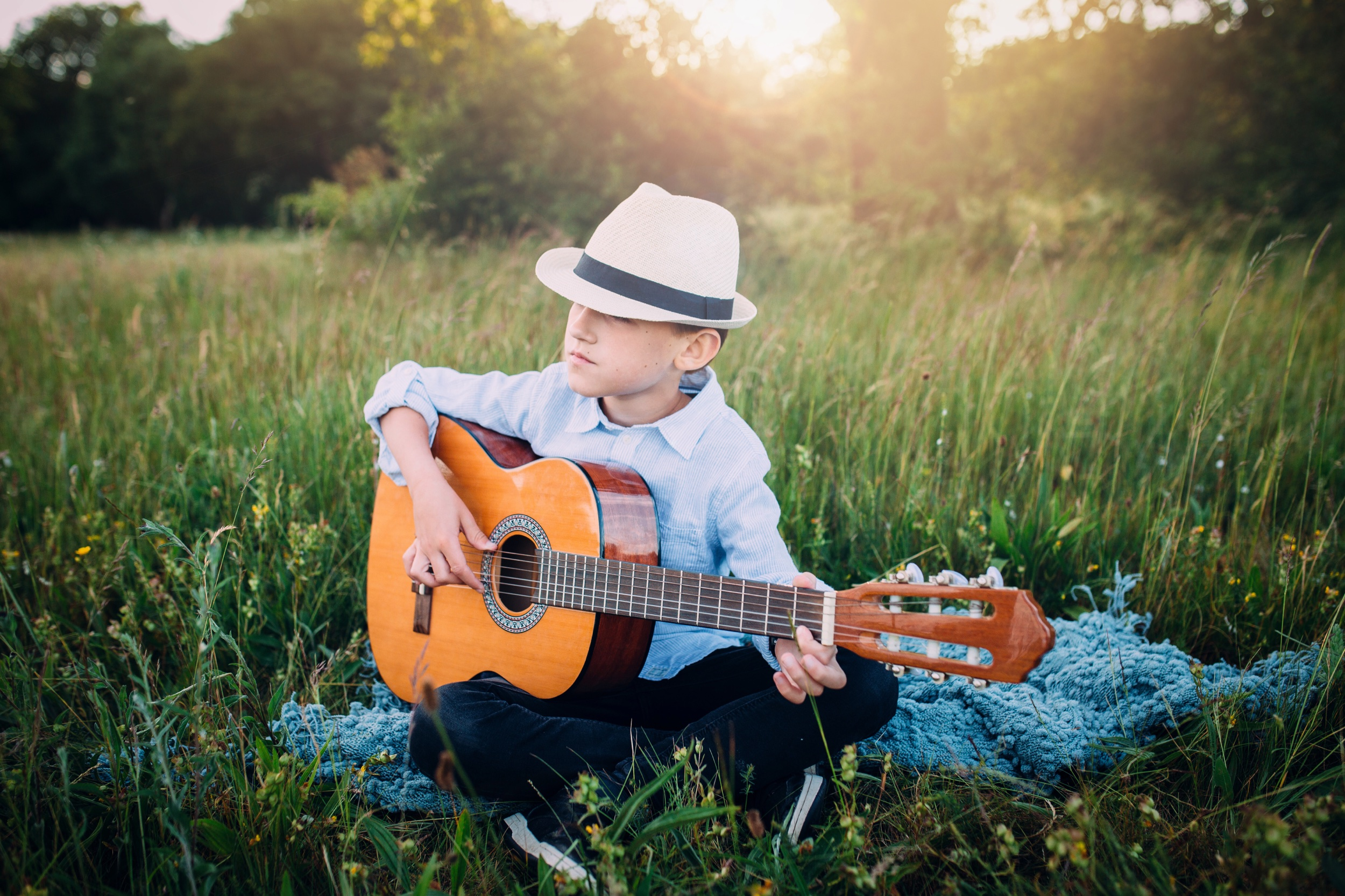 Boy with guitar family photography golden hour UK