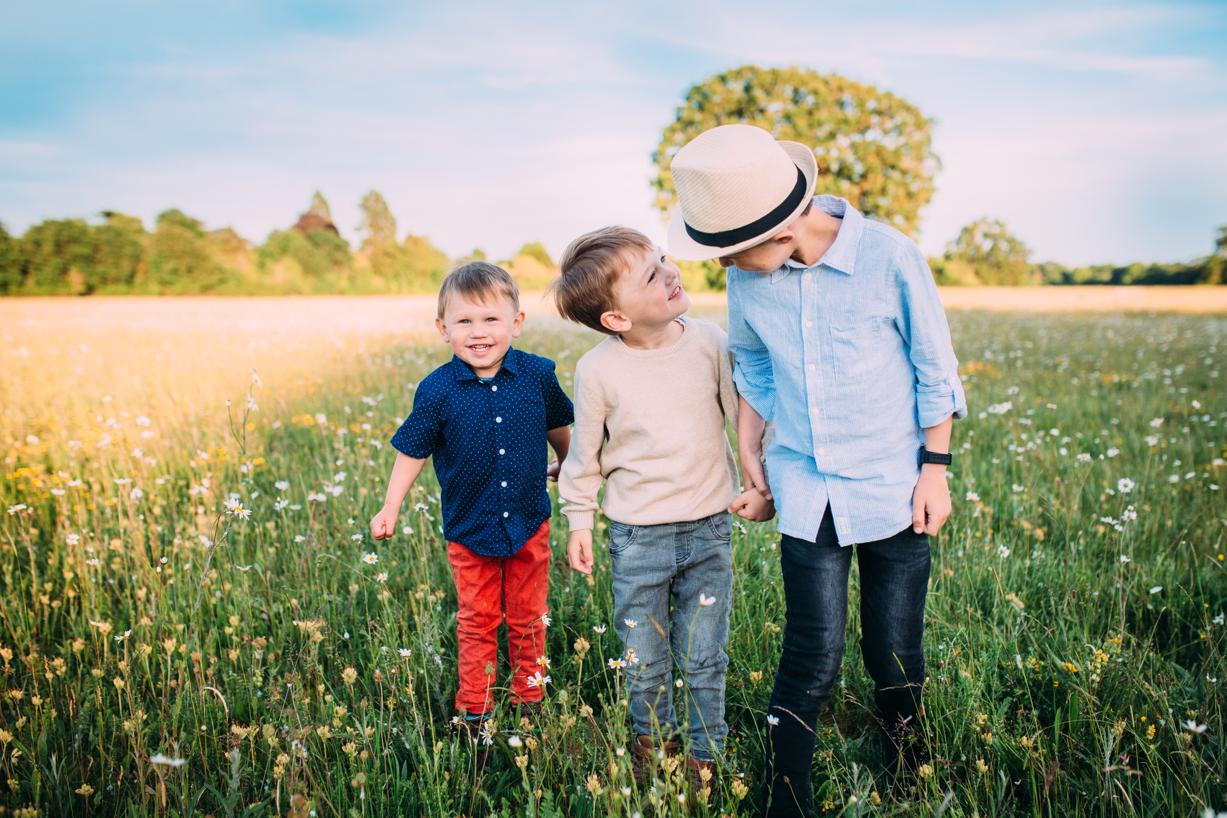 Three brothers in the field sunset family photography Ann Wo UK