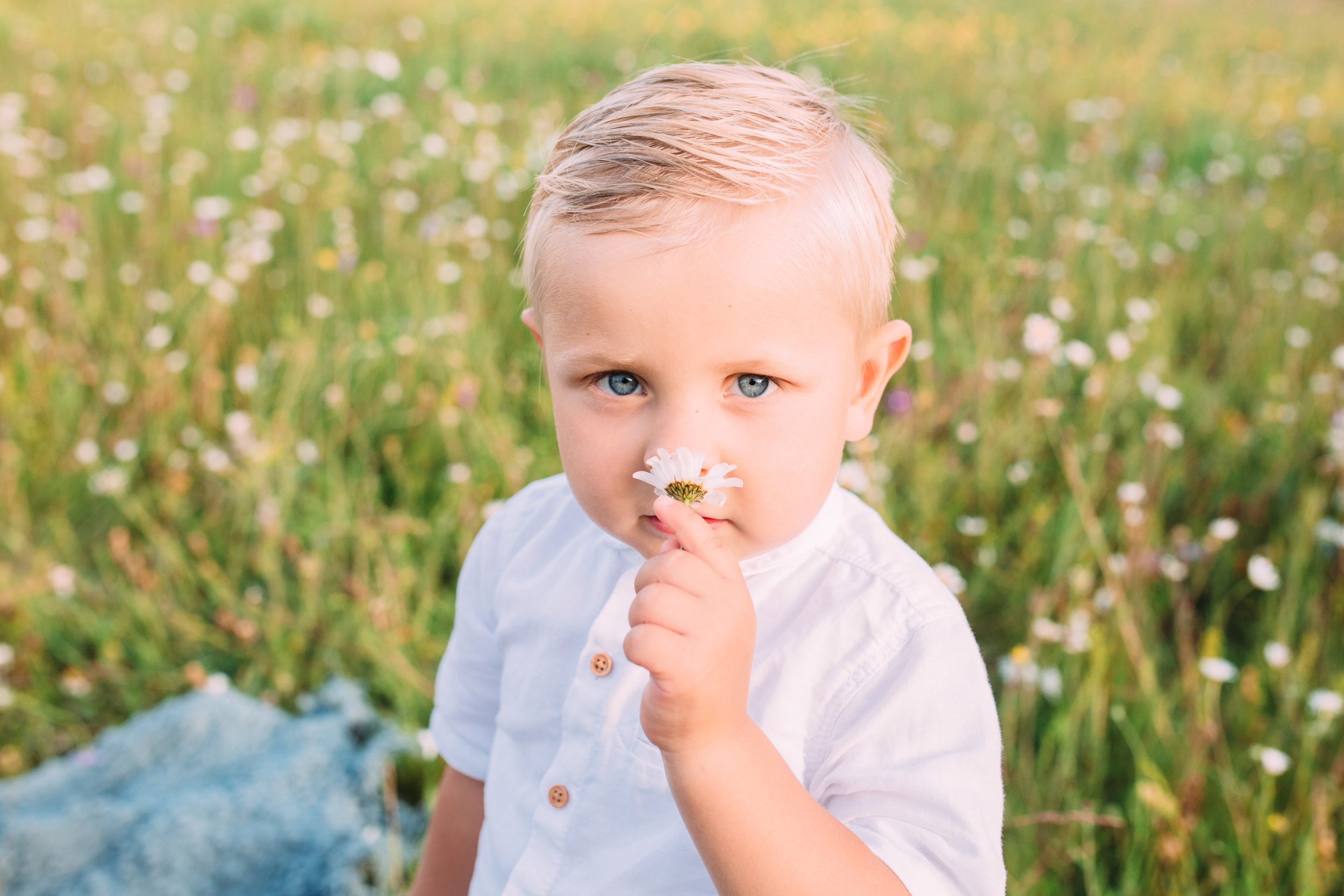smelling flower- outdoor family photography London
