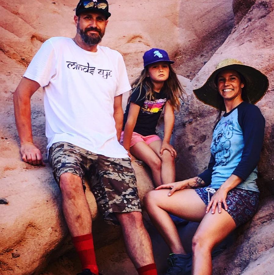 The beautiful Parkyn fam exploring the #redrocks   @mikeparkyn in Himalaya Tee & @courtneyparkynyoga in a One of a Kind #NAMASTE raglan tee