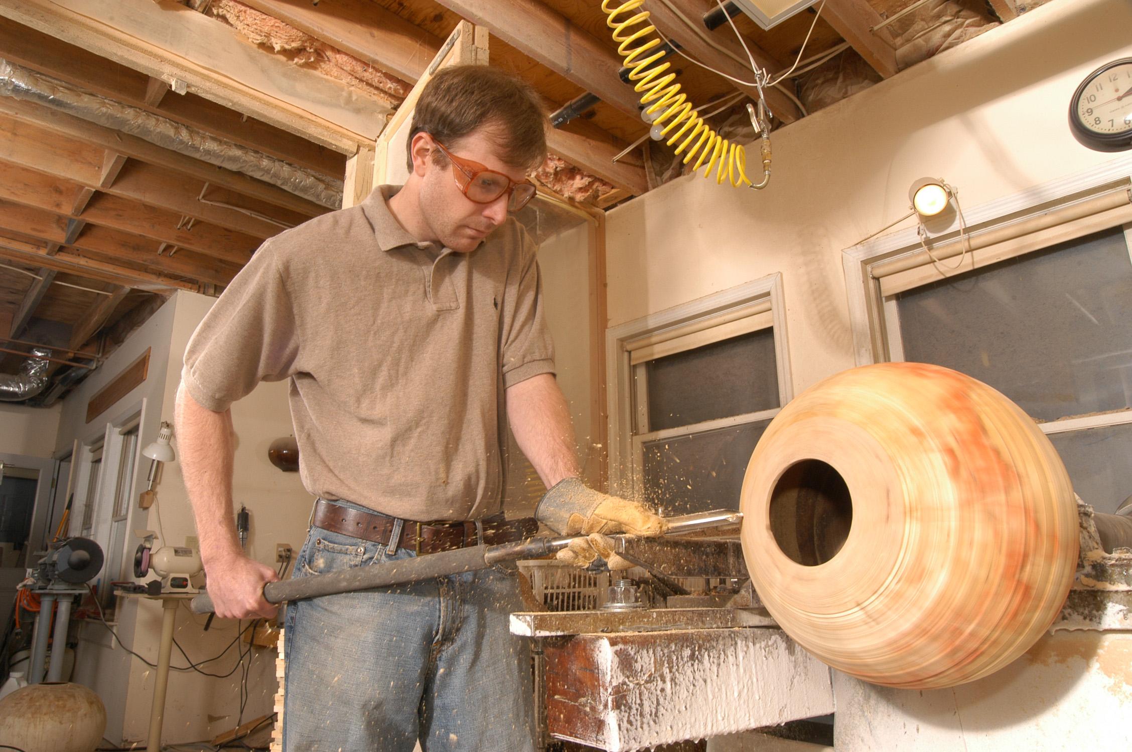 Artist Matt Moulthrop working in his studio.