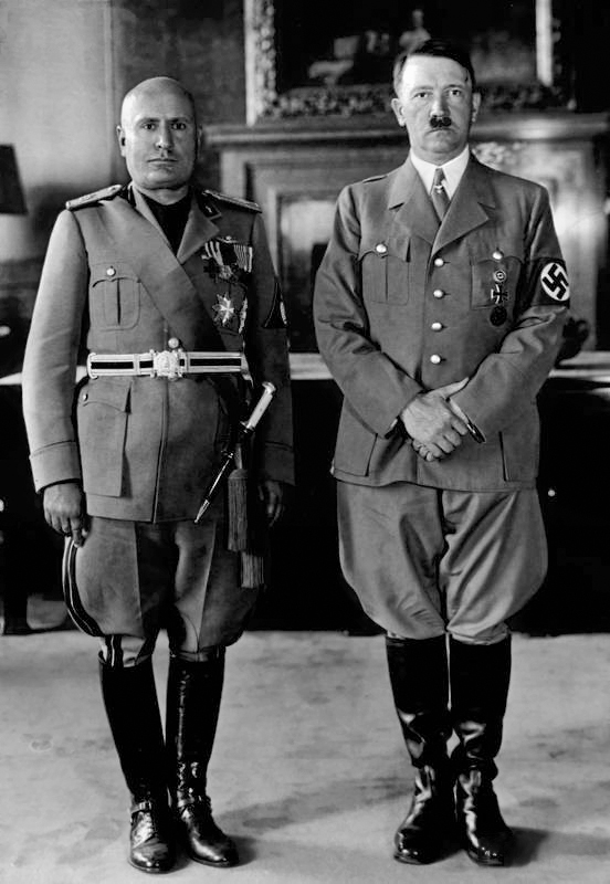 Arguably the most famous fascist leaders: (left) Benito Mussolini, the dictator of Fascist Italy during WWII, and (right) Adolf Hitler, the dictator of Nazi Germany (his own brand of fascism) during WWII.
