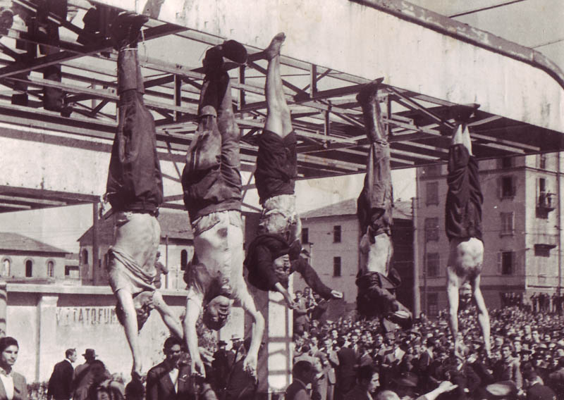 After their execution, Mussolini (second from left) and his followers were strung up for all to see. His mistress (third from left) was also one of those executed.