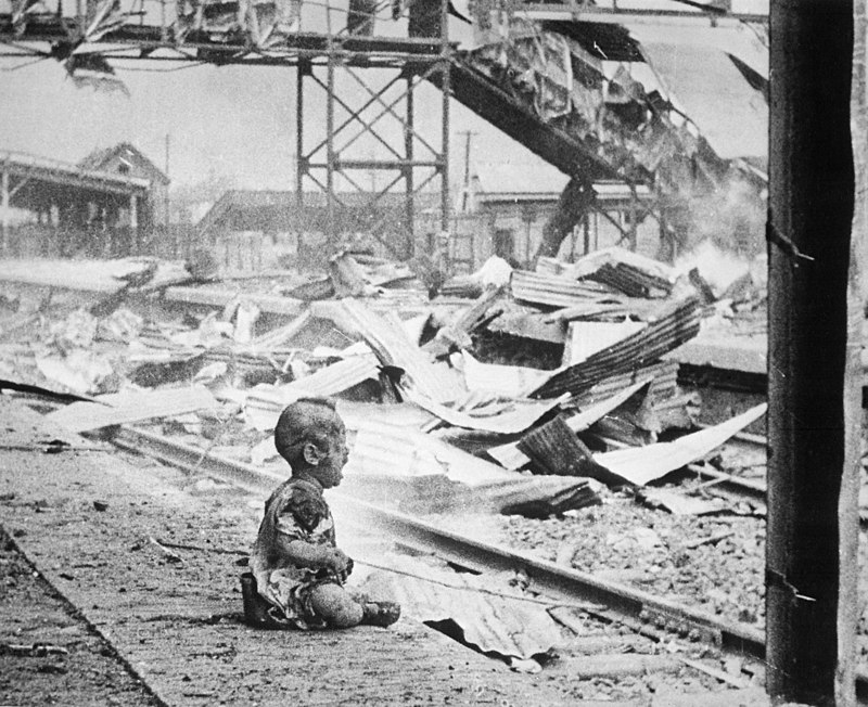 Bloody Saturday - an image of an infant on the train tracks (the body of his dead mother was nearby) in Shanghai after a Japanese bomb attack. August 1937.