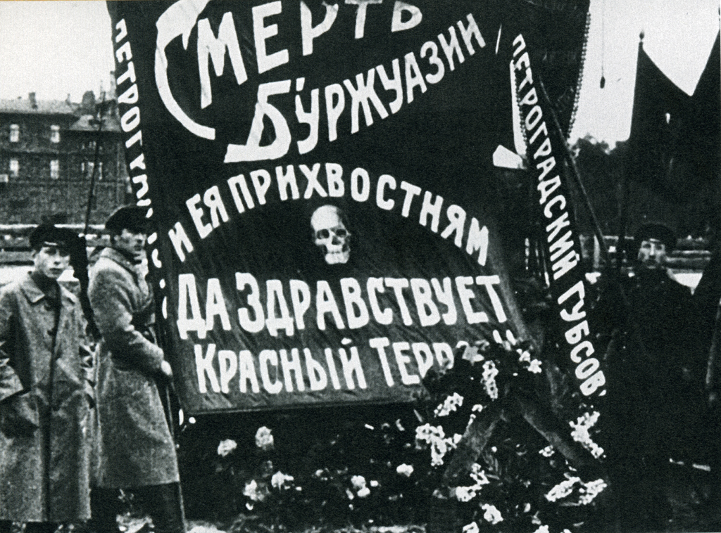 """""""Death to the Bourgeoisie and its lapdogs - long live the Red Terror"""" sign in Petrograd (now St. Petersburg) in 1918."""