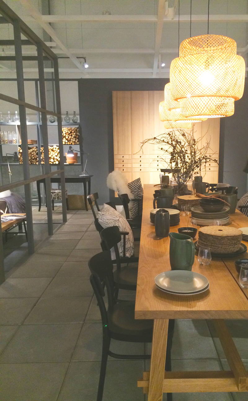 In the adjoining dining room, Ilse Crawford's new products were on display. The wicker light fixtures, pitchers and plates are all part of her collaboration with IKEA.