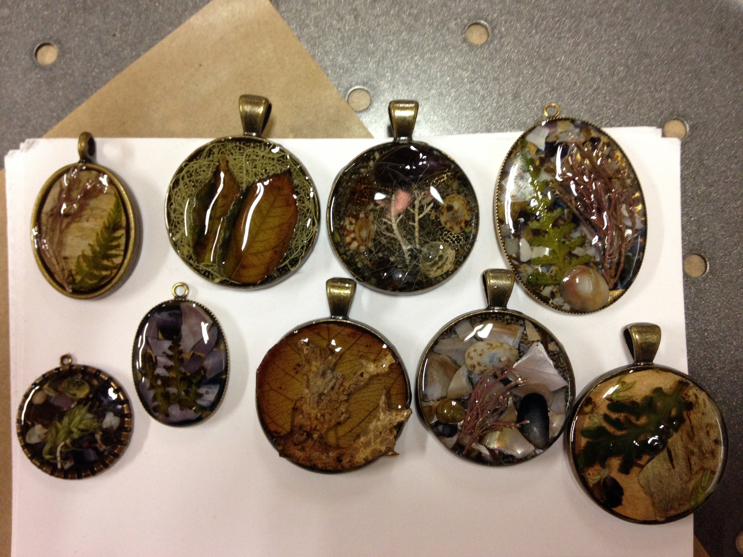 A few of the lovely pendants crafted at our latest Never-2-Old workshop!