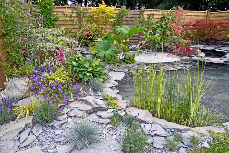 A rockery featuring a pond ( https://www.awbsltd.com/news/A-guide-to-buying-and-using-rockery-stones )