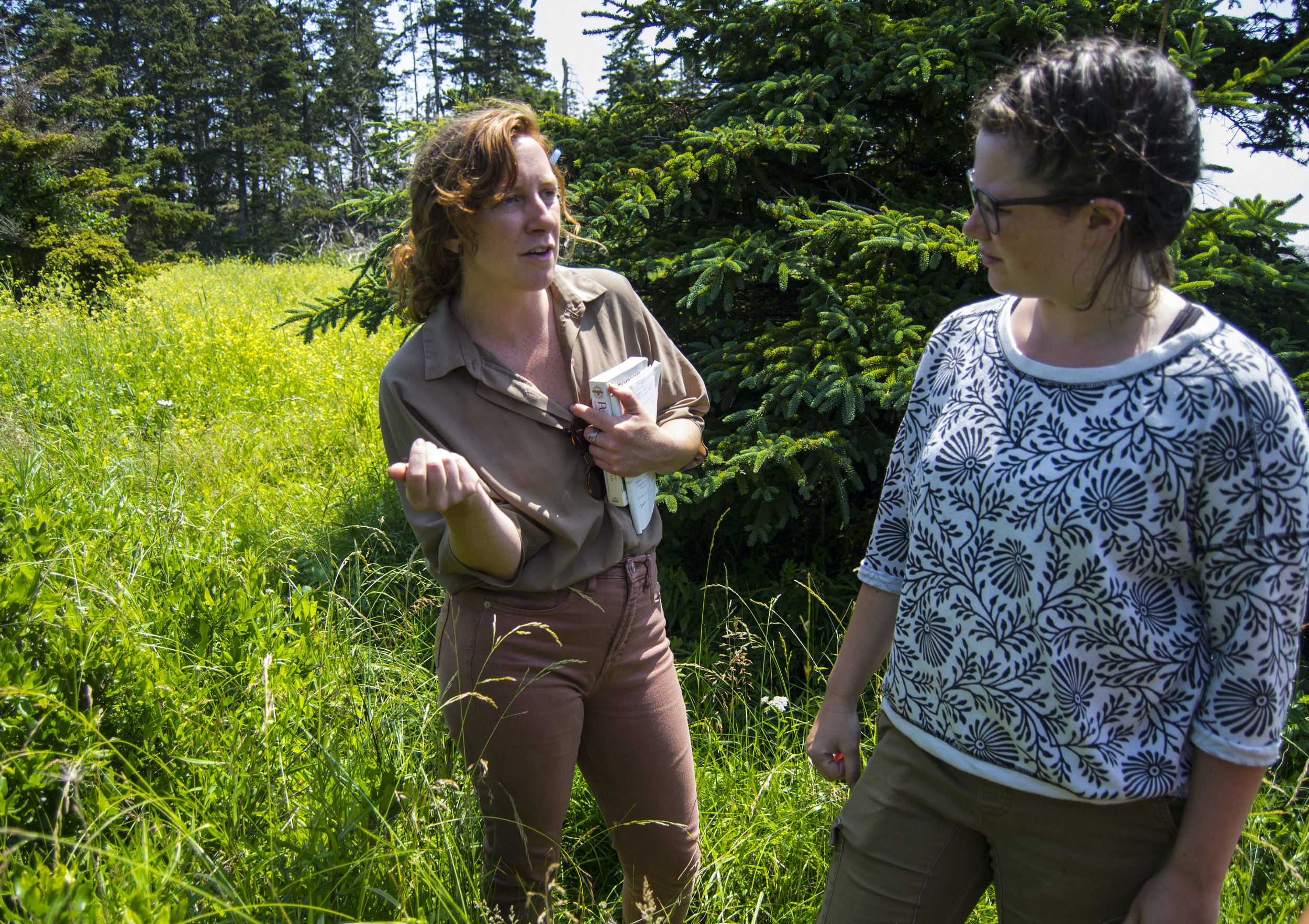 Mackenzie (right) learning about the medicinal plants found in the HLC forest from herbalist-in-training, Erica Fraser (left).