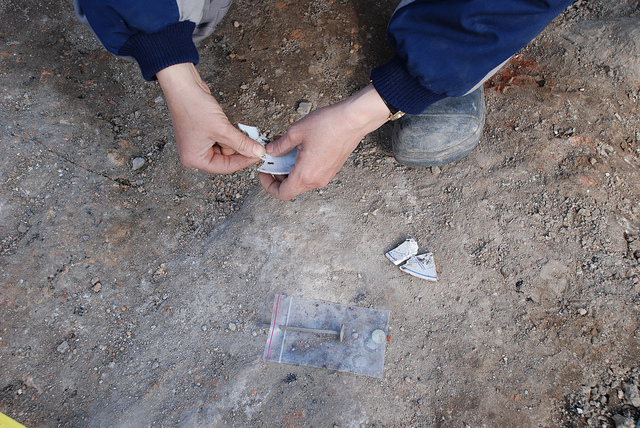 An archaeologist methodically putting the pieces together.