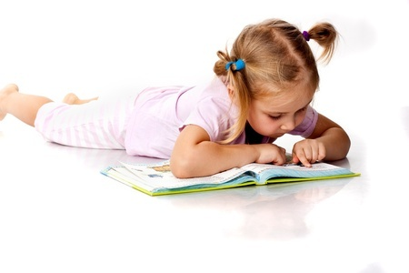 child reading and writing