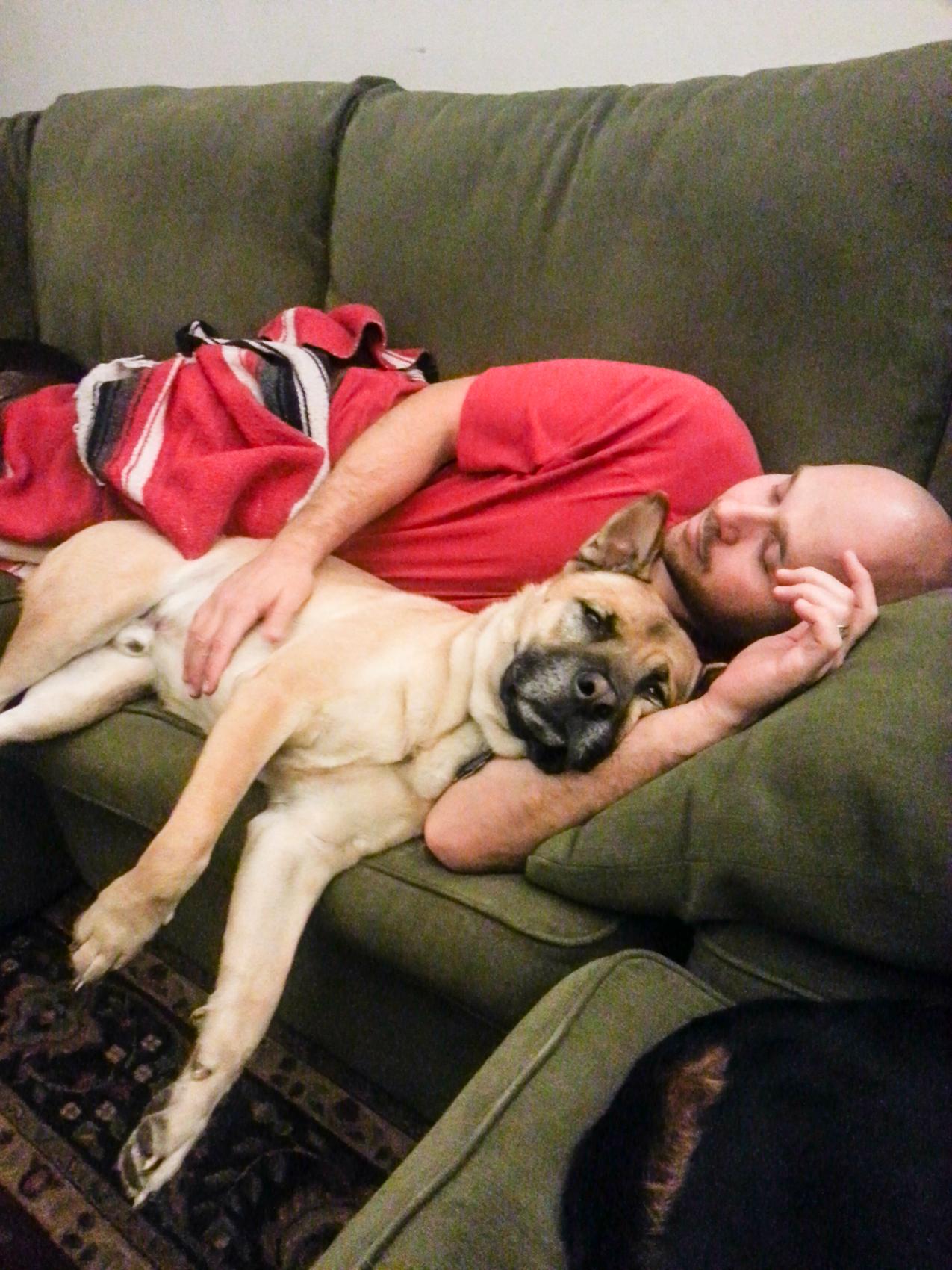 Kendo snuggles with his dad