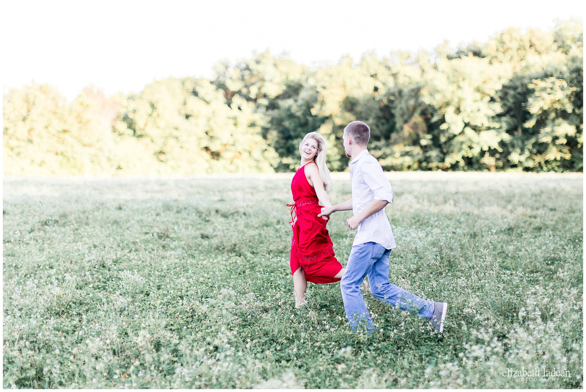 Running through a field of flowers engagement session