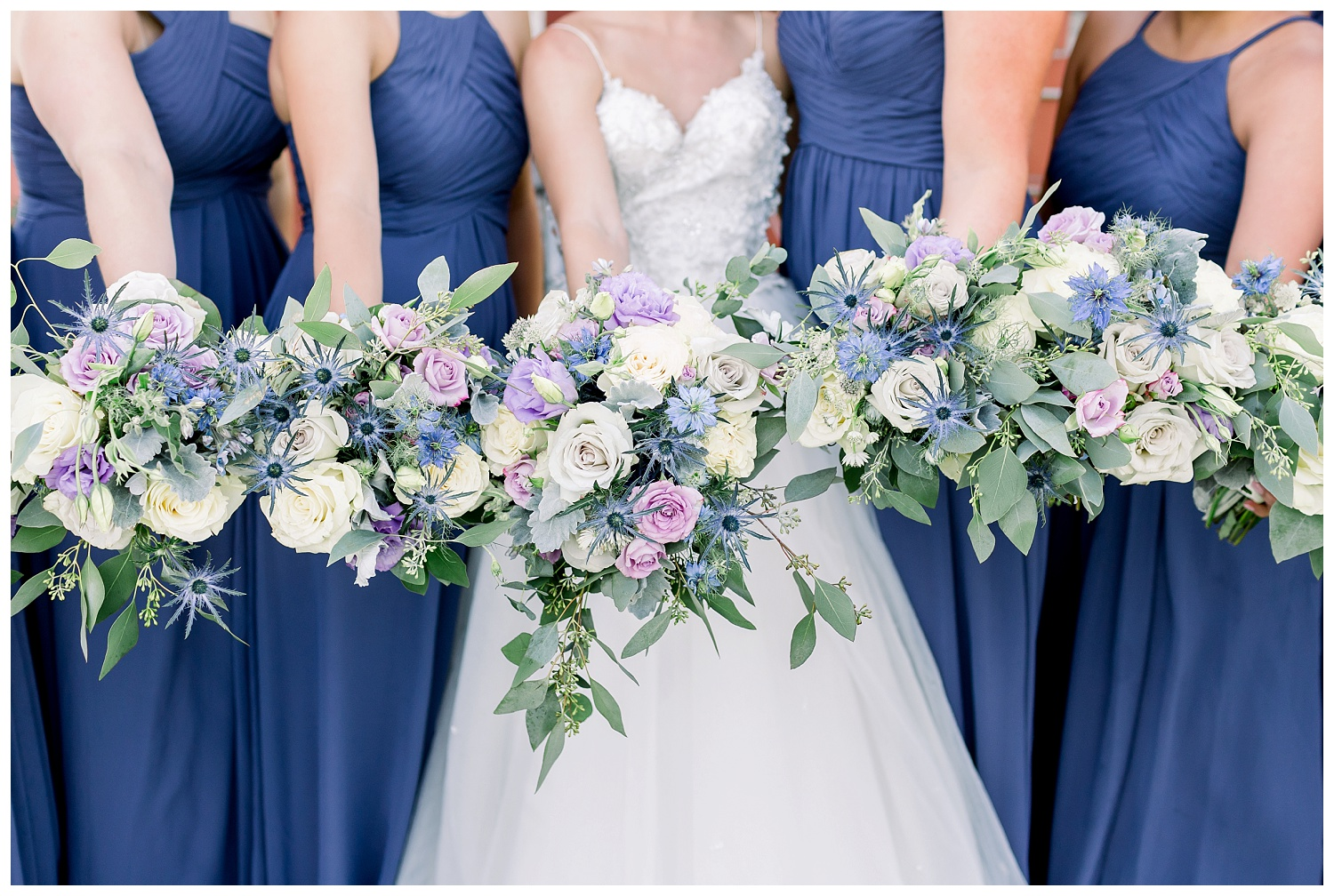 Purple bridesmaid dresses and bouquets