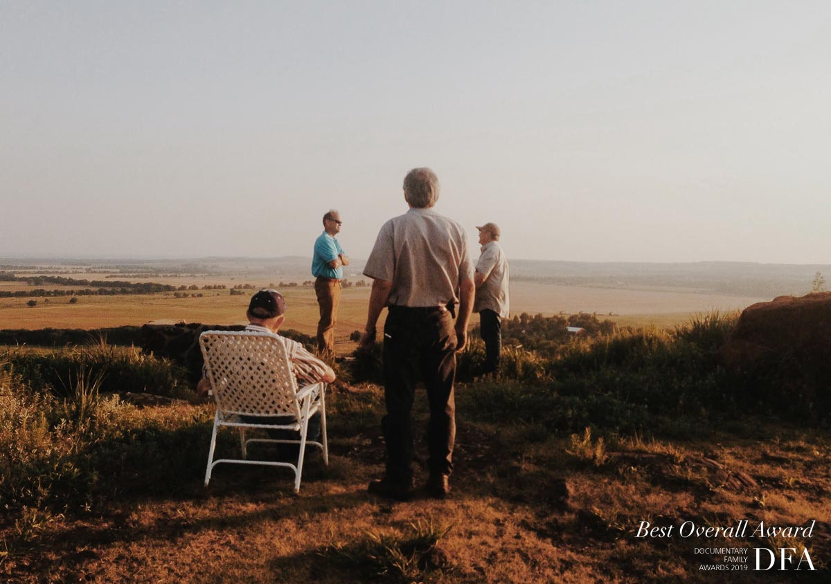 """This photo was taken in a few years ago following the final wheat field of the summer harvest season. We were taking in the sights of Coronado Heights. This moment is a minor capture of what happens post-harvest. We want to relish in the moment of """"we did it, two long and hard weeks, but we did it."""" We are all exhausted, but connection and family have always been a priority."""