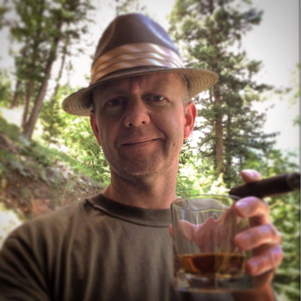 A lovely afternoon in the mountains of Colorado enjoying single malt scotch and a cigar.