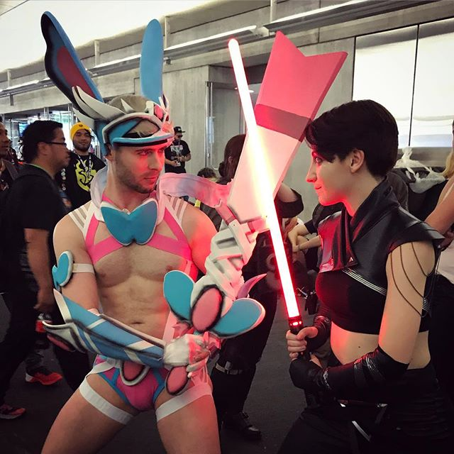 This lovely, impeccable woman is a highlight of ever Con I see her at. #lightsaber #sylveon #shiny #shinysylveon #pokemon #starwars #sith #lovely #redglow #glow #pose #fight #swords #warrior #pokemoncosplay #cosplay #costume #sylveoncosplay #comiccon #comicon #nyccomiccon #nyccomiccon2017 #comiccon2017 #fun