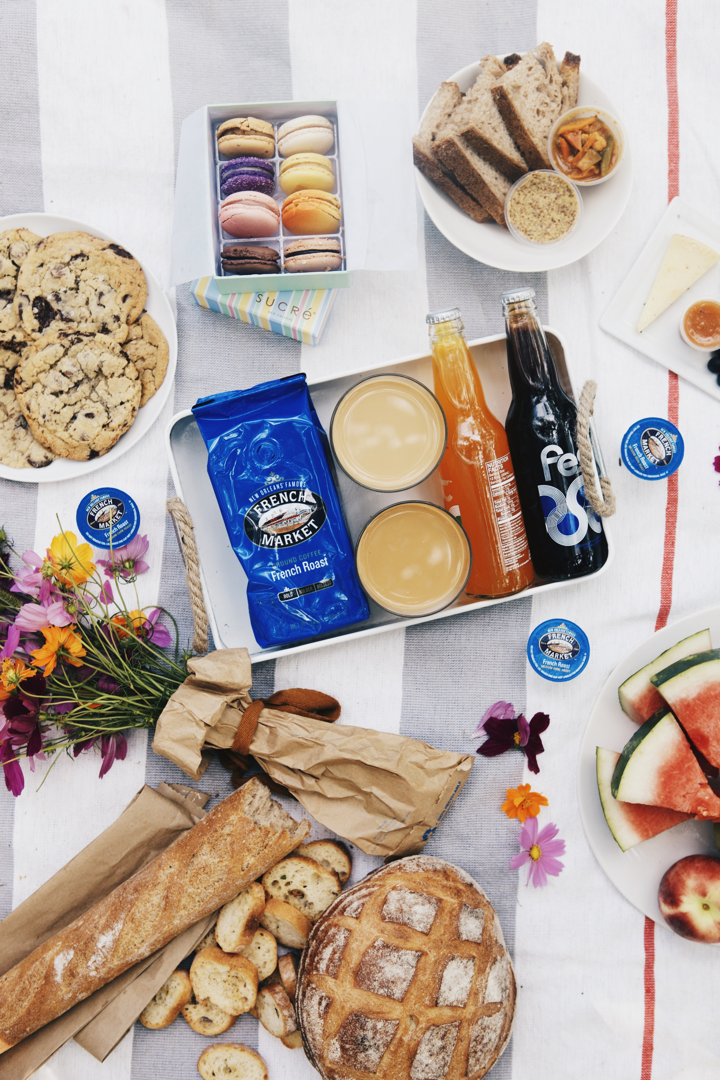 the quintessential City Parkpicnic: meats and cheeses from St. James Cheese Company, an overflow of freshly-baked breads from La Boulangerie, colorful macarons from Sucreand iced French Market Coffee French Roast.