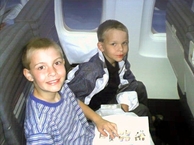 Two excited boys on the flight to Puerto Rico.