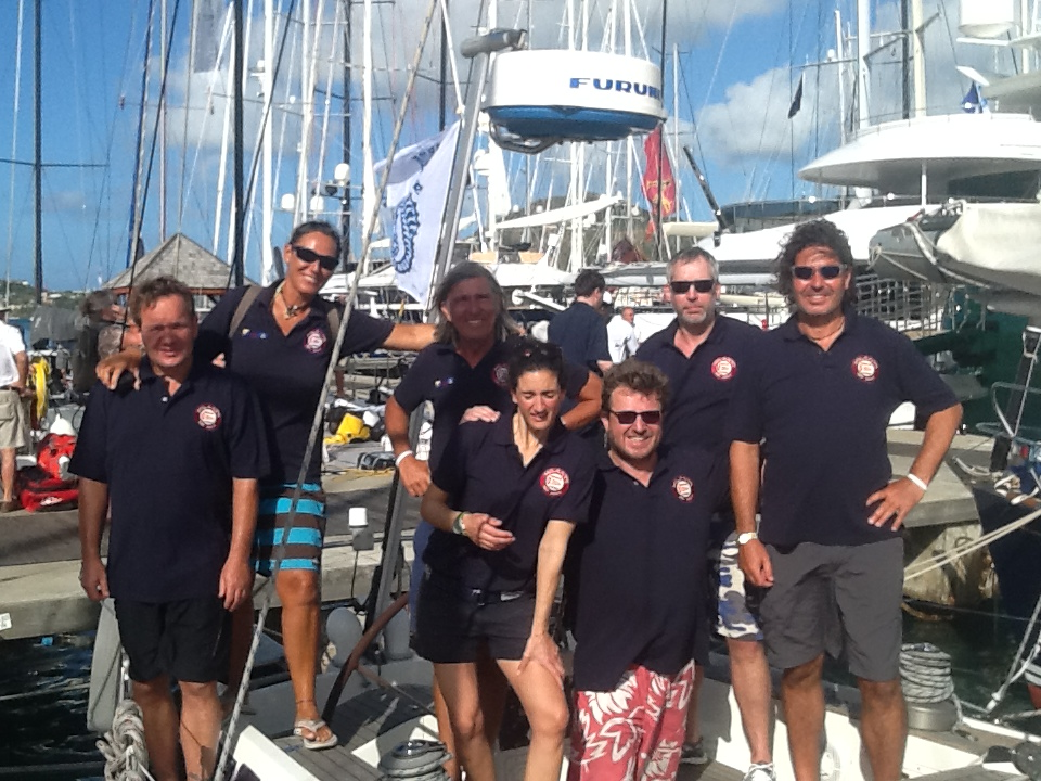 The team before the regatta -now they are back in Antigua relaxing in the bar after quite a tough time beating the waves.