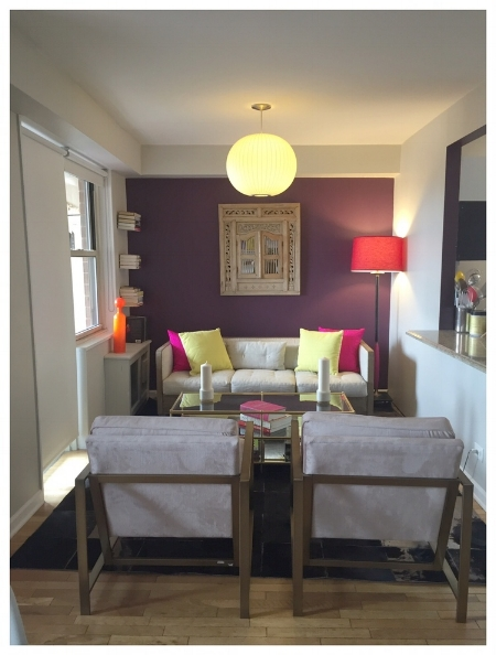 We swapped her office space into her Living room as she had great views of the city.  She invested in a stylish new sofa, and 2 Milo Baughman style chairs in a pale pink velvet.  We reused her beautiful carved Indian mirror that was on her balcony and made it the focal point on a dark aubergine wall, that also reflected light, making the space feel bigger.